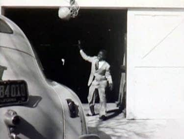 Johnnie Cochran packing up the car to move to California with his family
