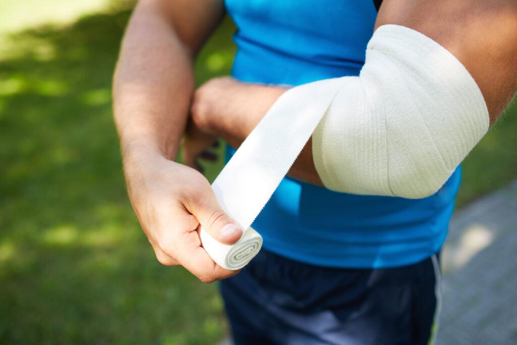 Man Bandaging Elbow